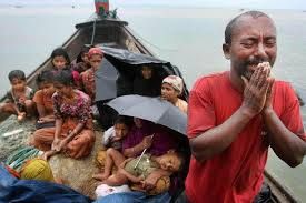A Rohingya man pleads with authorities as families try to shelter on a typical boat used by migrants to escape the Bangladesh Myanmar border area Source Bangkok Post