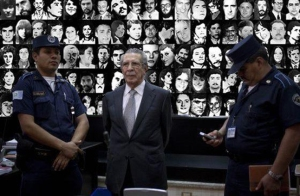 Rios Montt with his victims in the photos behind  Photo Credit  Gabriela Alvarez Castaneda