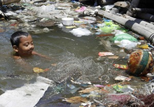 A boy swims in polluted Manila Bay  Photo credit Cheryl Ravelo  Reuters