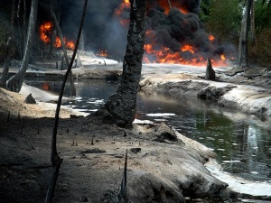 Oil from a leaking pipeline burns in Goi-Bodo, a swamp area of the Niger Delta in Nigeria October 12, 2004. Oil company Royal Dutch Shell said the leak was caused by unknown saboteurs on Monday who used a hacksaw to cut open a major pipeline feeding oil to an export terminal at Bonny, southern Nigeria. The fire was still raging on Wednesday, but the company said the impact on oil output was minimal. Picture taken October 12, 2004. REUTERS/Austin Ekeinde Pictures of the Month October 2004 TA/RSS/WS - RTRDAI9