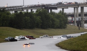 Cars are stranded on 288 at the 610 loop, which became flooded after an afternoon downpour in Southwest Houston, Saturday, April 27, 2013. (AP Photo/Houston Chronicle, Cody Duty)