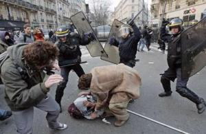 Police brutality at a protest in Paris. Source Getty