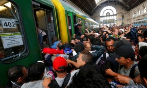 Refugees in Budapest, Hungary. Source The Guardian.