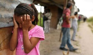 Central America. A young girl cries as her home and neighborhood are forcefully dismantled in a shanty town after the government claimed that the settlement was illegal. Photo Spencer Platt Getty