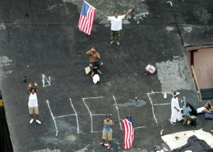 Residents wait on a rooftop to be rescued from the floodwaters of Hurricane Katrina on Sept 1, 2005 Photo by STR Reuters