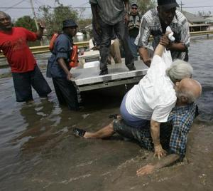 Woman collapses while residents attempt to rescue her and husband from flood waters in the aftermath of Hurricane Katrina Photo source AFP