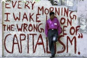 Every morning I wake up on the wrong side of Capitalism. Source Street Art, Open Democracy.