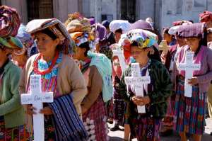 Guatemala women mourn the dead of their communities, decimated by crime and right wing militia violence. Photo by Brooke Anderson.