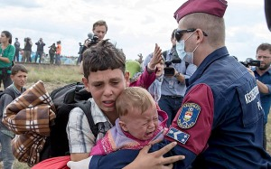 Refugees attempt to pass through Hungary. Photo source, The Telegraph.