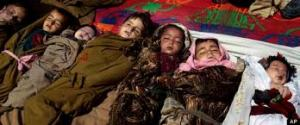 The bodies of Afghan children are laid outside home destroyed in US drone attack. Source, Associated Press.