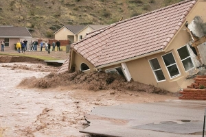 Homes fall to flash flooding in California. Source NBC News.