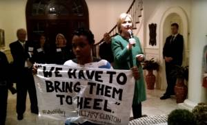 a-black-lives-matter-activist-silently-protests-hillary-clinton-at-a-funraiser-in-south-carolina-photo-source-salon